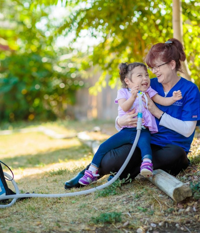 nurse with little girl outside