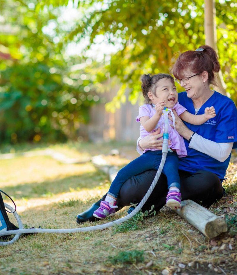 nurse with little girl outside