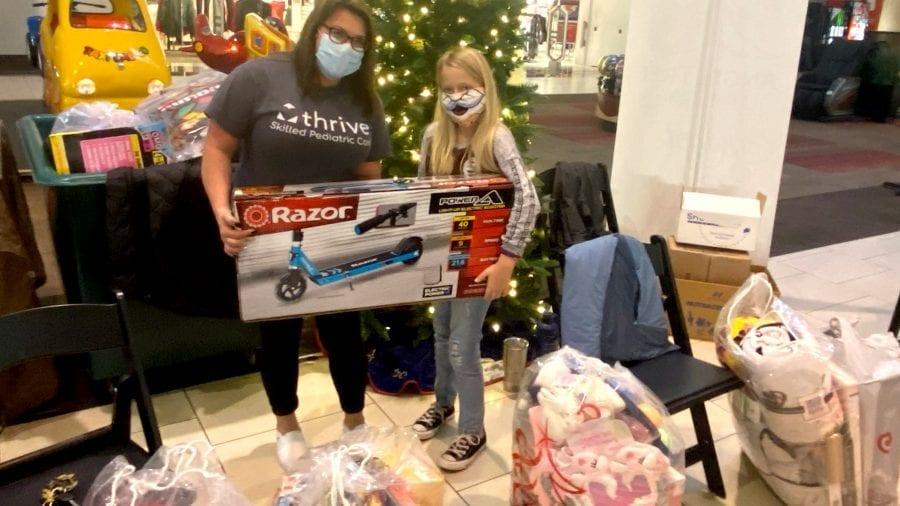 girl receiving razor scooter