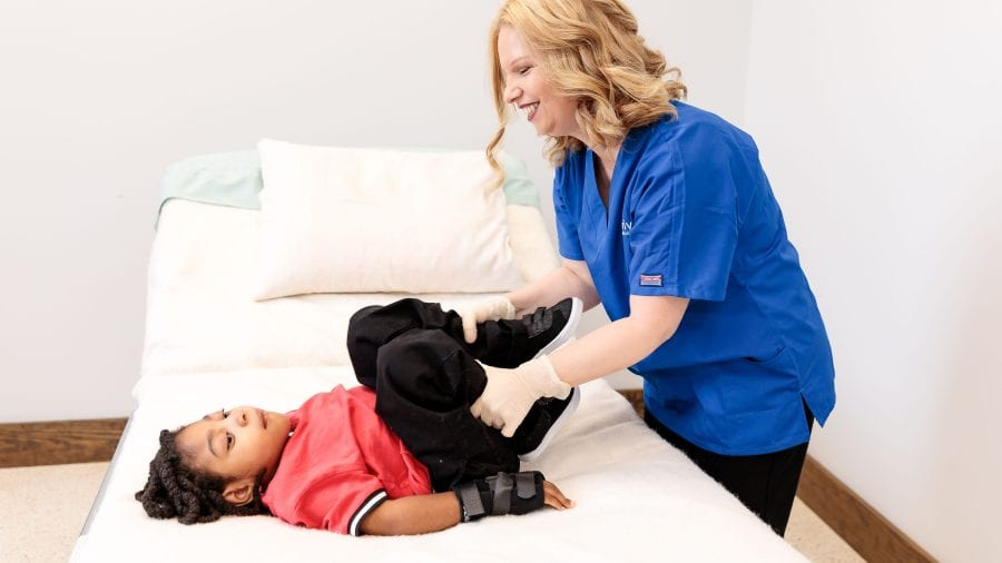therapy nurse with little girl