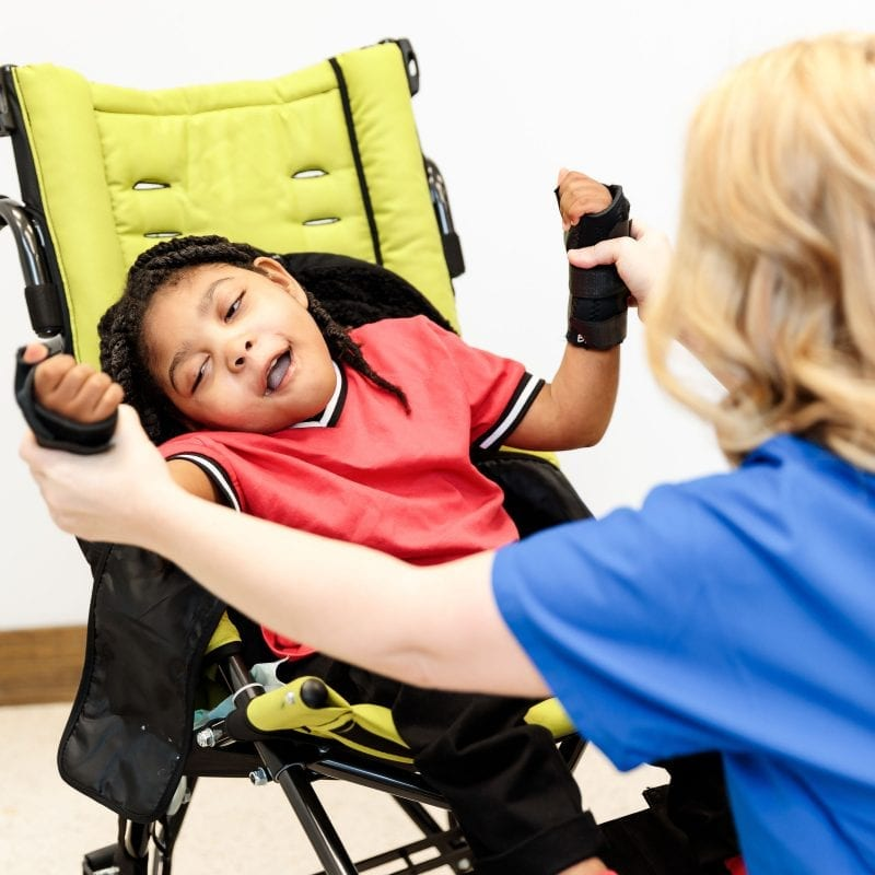 therapy with a child in a wheelchair