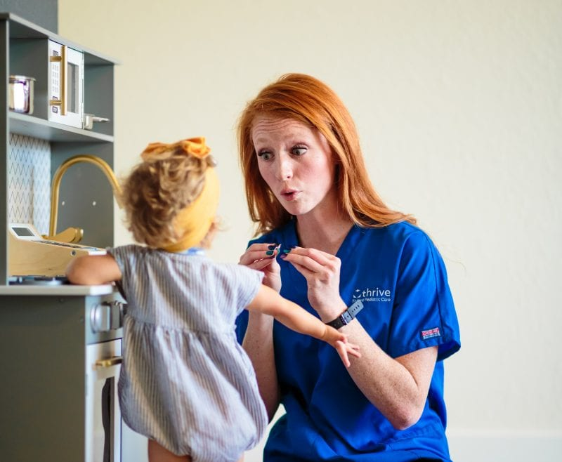 speech therapy nurse with little girl