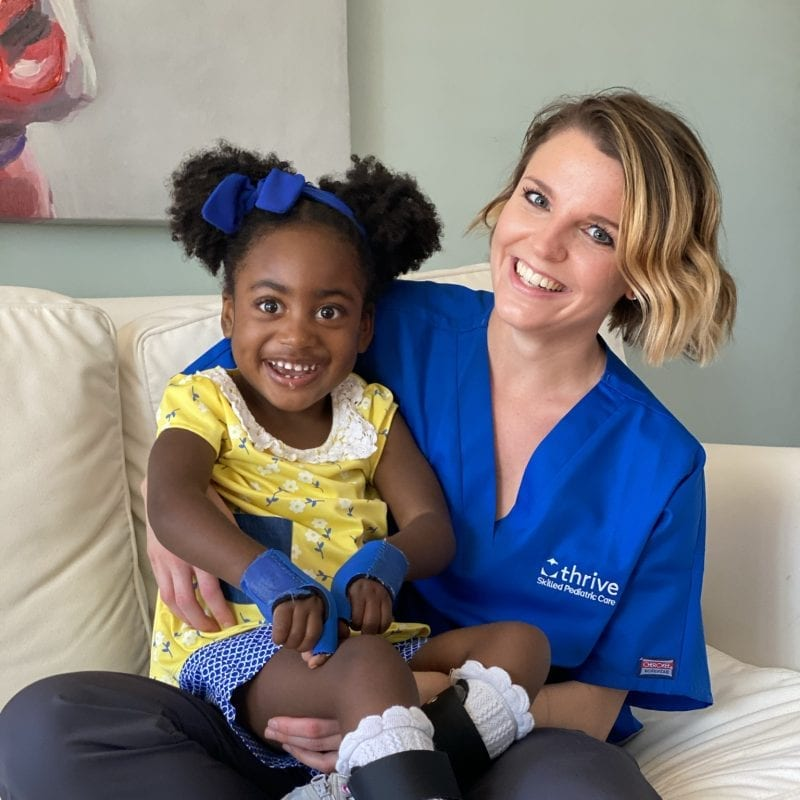 smiling little girl with thrive staff