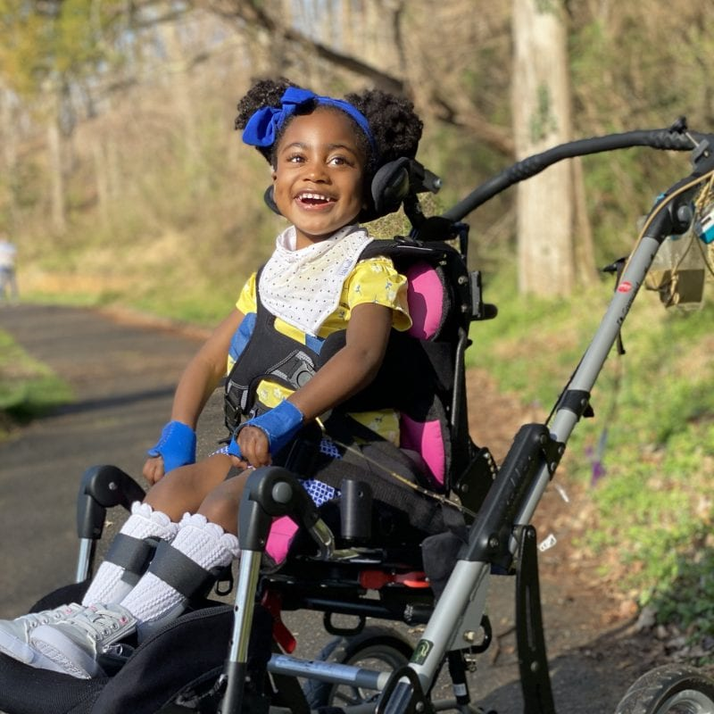 smiling little girl in wheelchair